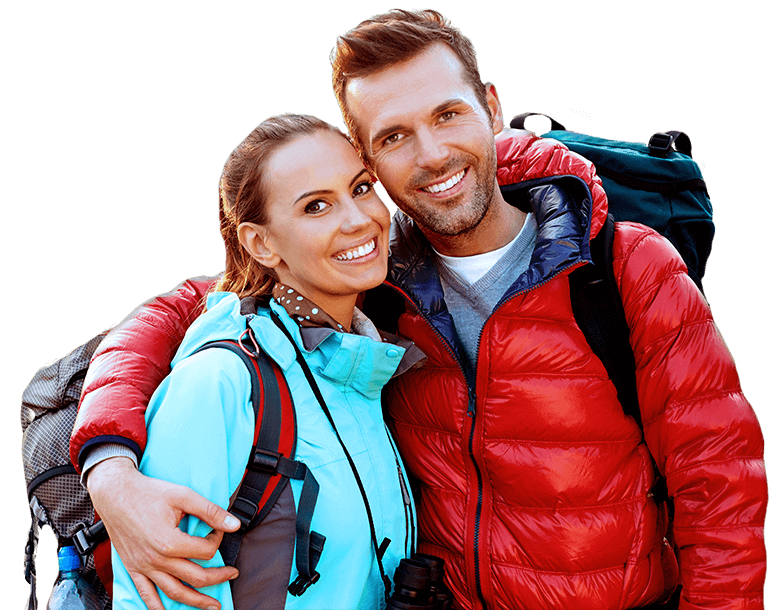 Smiling man and woman with hiking gear