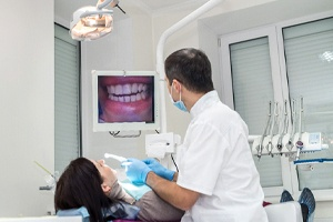 Dentist and patient discussing Chao Pinhole Surgical Technique