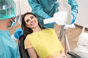 A dentist talking to a female patient about dental implants