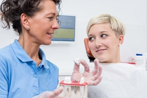 Lakewood implant dentist discussing dental implants with patient