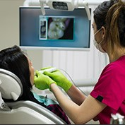 Dental assistant capturing smile images