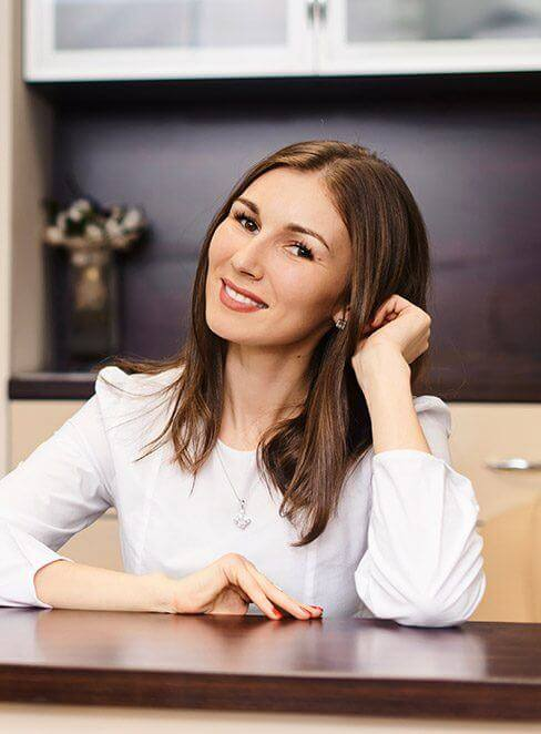 Smiling woman at reception desk