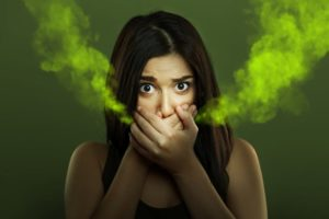 woman with bad breath who needs a dentist in Lakewood
