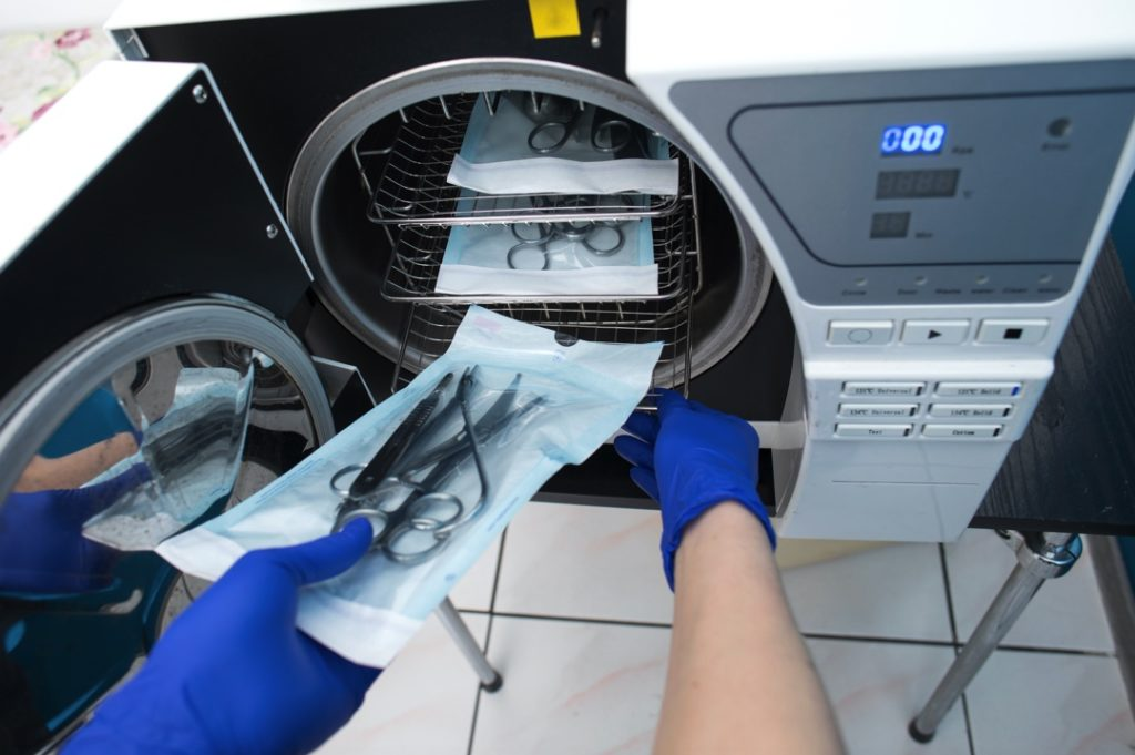 Dentist in Lakewood using an autoclave