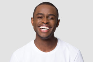 Man smiles after getting smile makeover in Lakewood